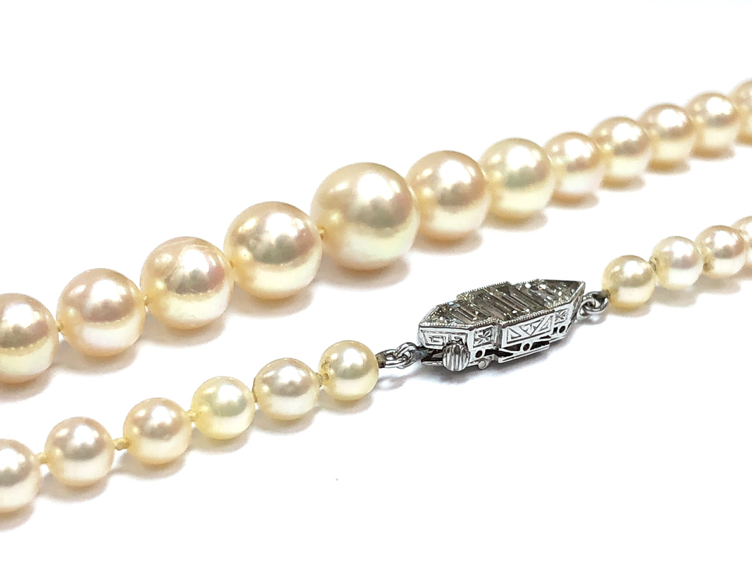 Art Deco Era antique graduated pearl necklace with a stunning platinum & diamond clasp set with baguette and triangle brilliant cut diamonds.  Hand-chased gallery with millegrain detailing, and antique safety latch.
