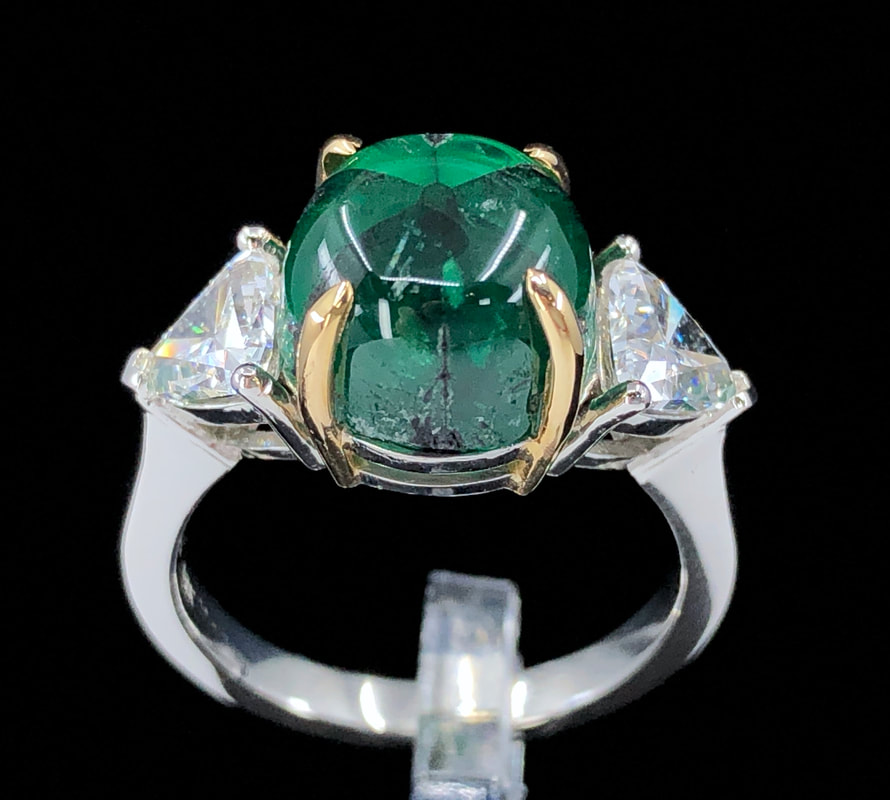 GRS 5.42 ct. natural Colombian trapiche emerald and trillion cut diamond three stone ring in platinum with 18K yellow gold claw prongs.