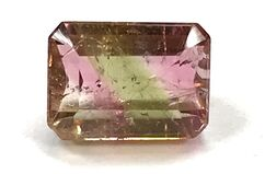 Emerald cut watermelon tourmaline with many inclusions.