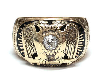 Double-headed eagle emblem of the Scottish Rite, on a 32nd Degree Freemason ring set with a 1/4 carat old mine cut diamond.