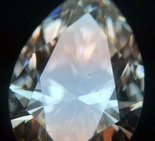 A laser drill hole is visible on the table of this marquise diamond