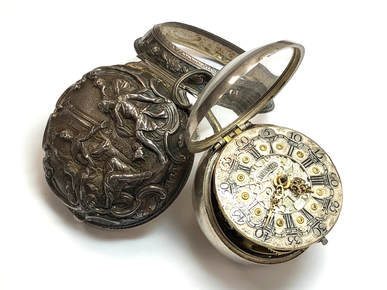 Georgian Era pair case pocket watch with repoussé sterling silver outer case,  ornate dial and hands.  Circa 1785