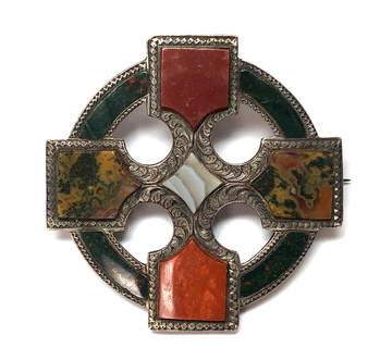 Victorian era antique Scottish agate brooch set with orange jasper, moss agate, banded agate, and bloodstone in a hand chased sterling silver frame