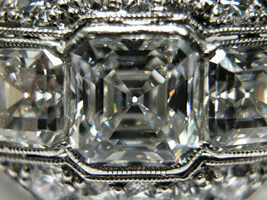 Asscher cut diamond (square shaped step cut with clipped corners)
