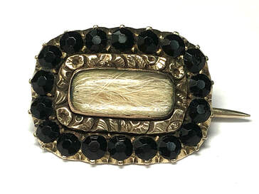 Georgian Era antique 14K gold blonde hair mourning brooch with French jet surround, dated 1826