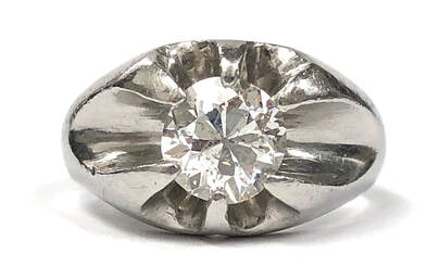 Vintage solitaire diamond ring in a platinum belcher setting