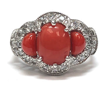 Precious red coral was custom cut to fit this vintage platinum & diamond ring setting