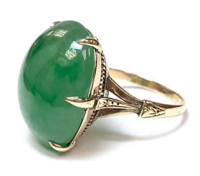 Art Deco era vintage jadeite jade ring in a custom-made, 18 karat gold setting with a filigree under gallery.
