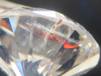 Bright red/orange flash in a fracture-filled diamond
