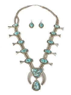 Demi-parure of vintage Southwestern Navajo sterling silver & turquoise Squash blossom jewelry