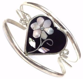 Mother of pearl, diamond and jet inlay in a sterling silver cuff bracelet.