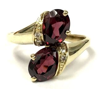 Rhodolite garnet and diamond bypass ring in 14K gold, by designer, David Trabich