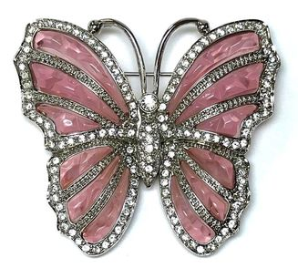 Nolan Miller butterfly brooch featuring pink plastic and clear rhinestones