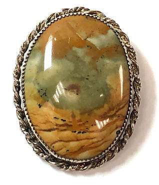 Beautiful landscape picture jasper hammer set in a sterling silver brooch with rope border