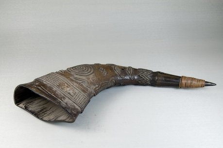 Large, carved buffalo horn on display at the Brooklyn Museum