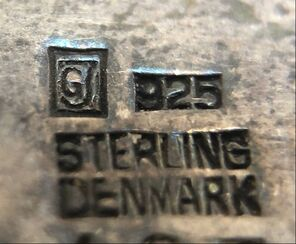 GJ - jewelry trademark of legendary Danish silversmith, Georg Jensen