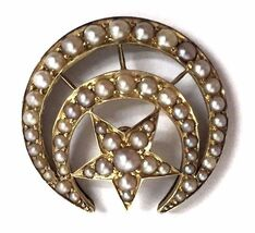 Late Victorian Era antique Masonic Shriners pin featuring graduated seed pearls in a crescent and star motif.