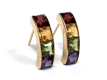 Vintage earrings featuring garnet, citrine, peridot and amethyst channel set in 14K gold